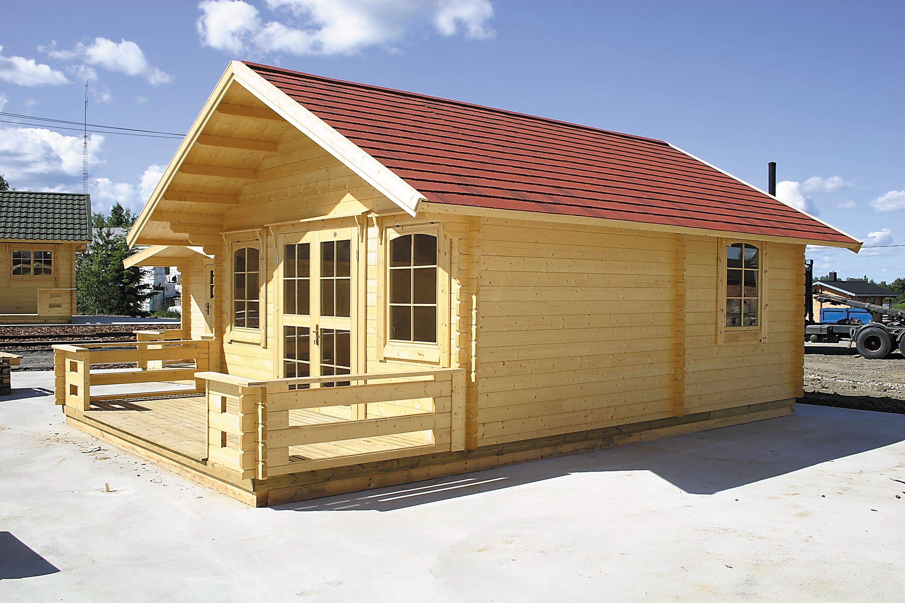 Abri de jardin en bois de 28m2 avec grande terrasse
